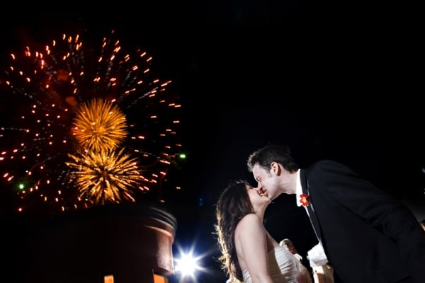 These lovebirds got affectionate during the fireworks show at their wedding.