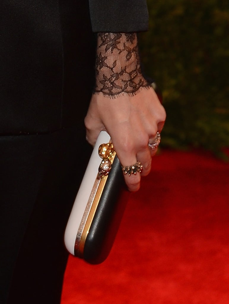 Jaime King carried a black-and-white Alexander McQueen clutch.