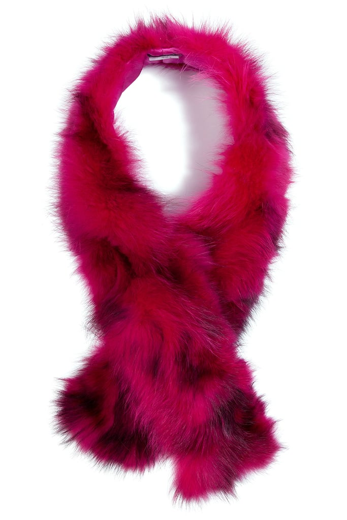 Winter has kicked into high gear, which means my bold brights have been replaced with moody hues and dramatic prints. What better way to boost my spirits, and keep me cozy, than this racoon fur scarf by Steffen Schraut ($270)? — MV