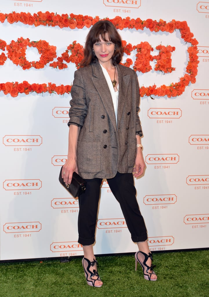 Milla Jovovich's cutout sandals were clearly the star of her casual look at a Coach event in Santa Monica.