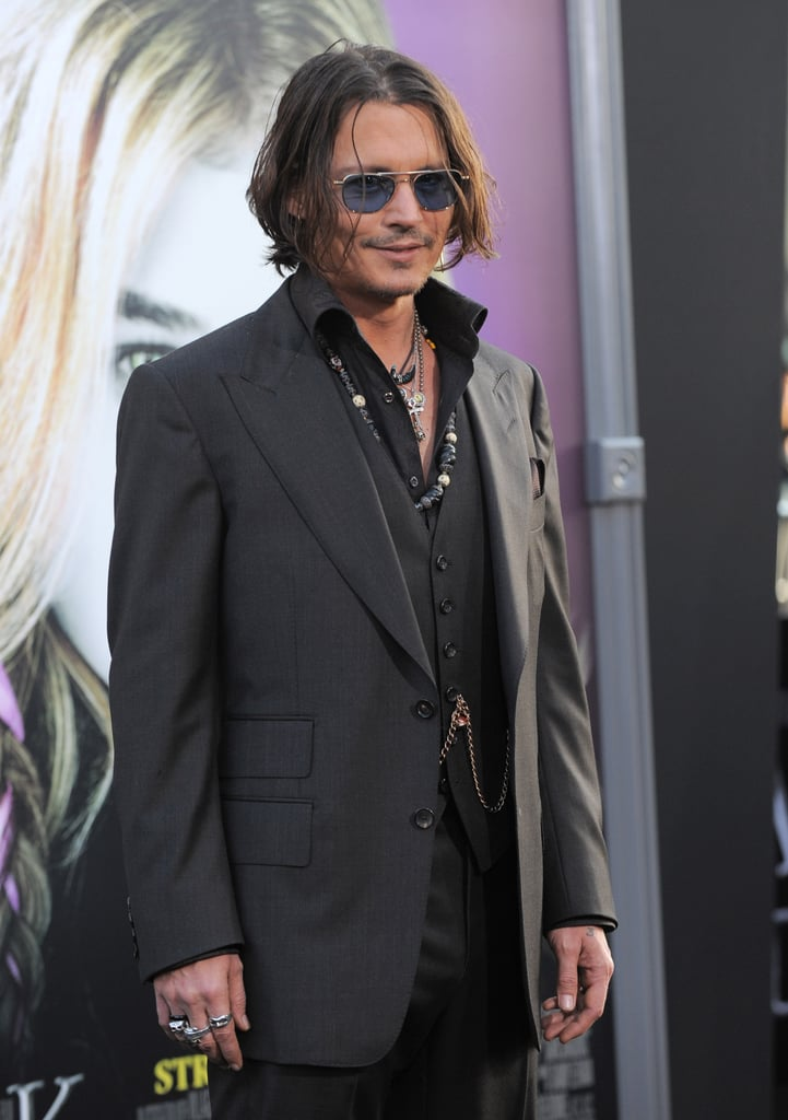 Johnny Depp gave a smile at the Dark Shadows premiere in LA.