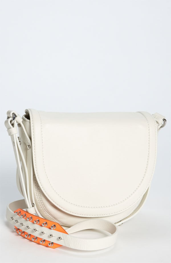 This white crossbody bag is adorned with silver spikes and a splash of orange, a simultaneously tough and chic feel. McQ Alexander McQueen Amwell Mini Crossbody Bag in Bone ($660)
