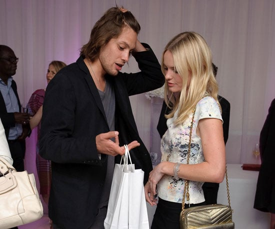 Photo Slide of Kate Bosworth and James Rousseau with Goodies from a Book Launch Party in London
