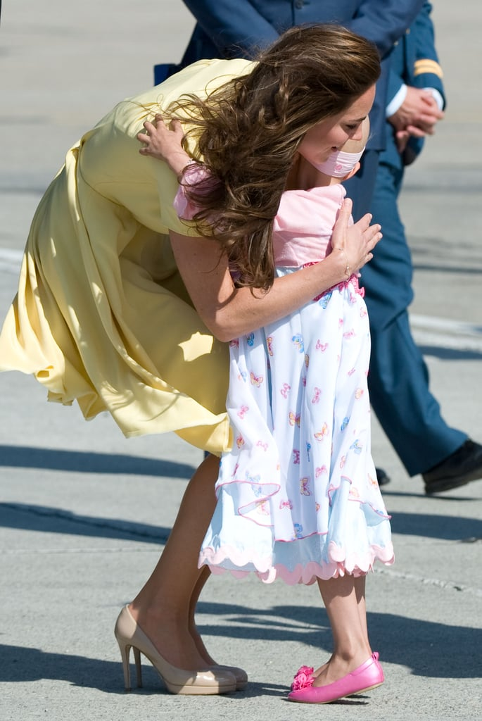 Kate hugged a sweet 6-year-old girl at the Calgary Airport during the royal couple's North American tour in July 2011.