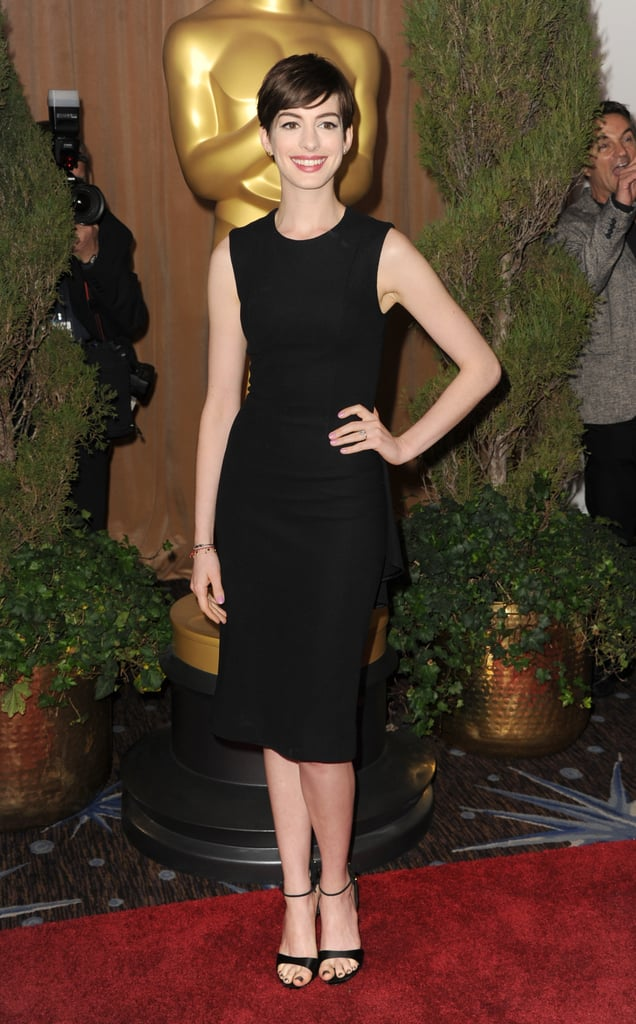 Anne Hathaway looked stunning in a black dress on the red carpet at the Oscars luncheon.