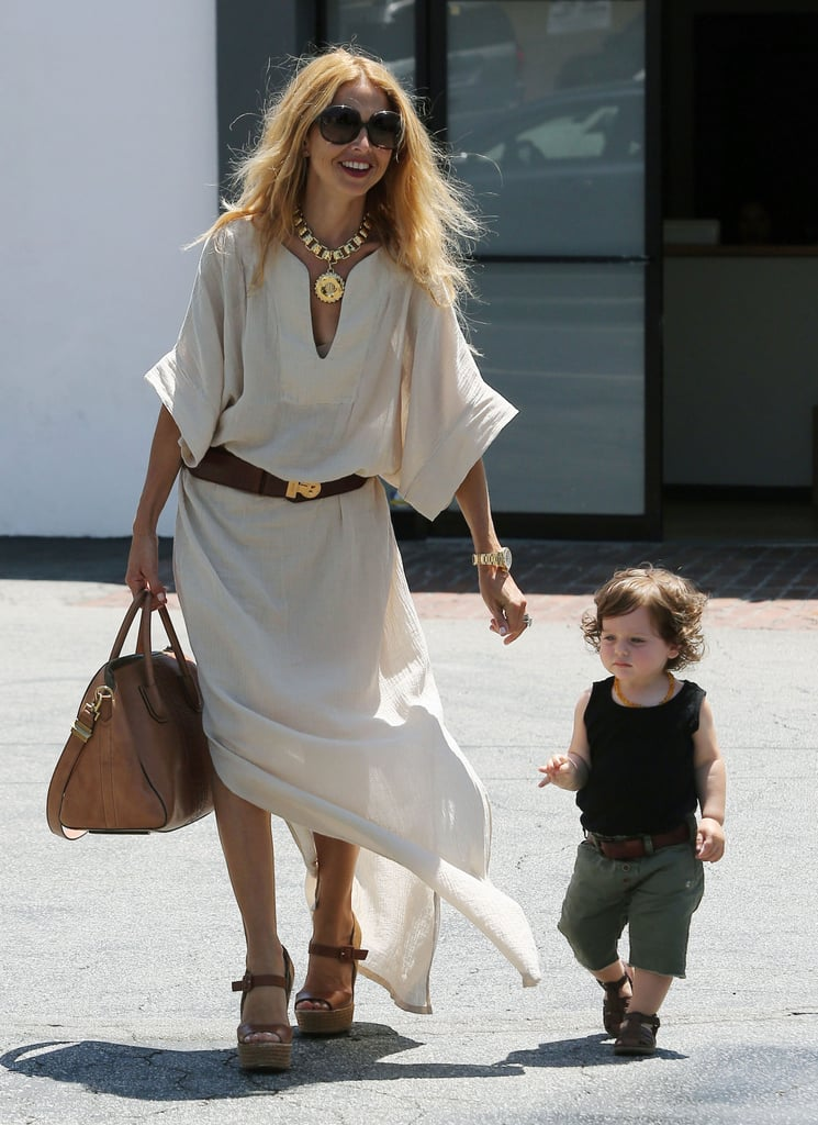 Rachel Zoe was effortlessly glam in a belted maxi and wedges (with baby Skyler at her side).