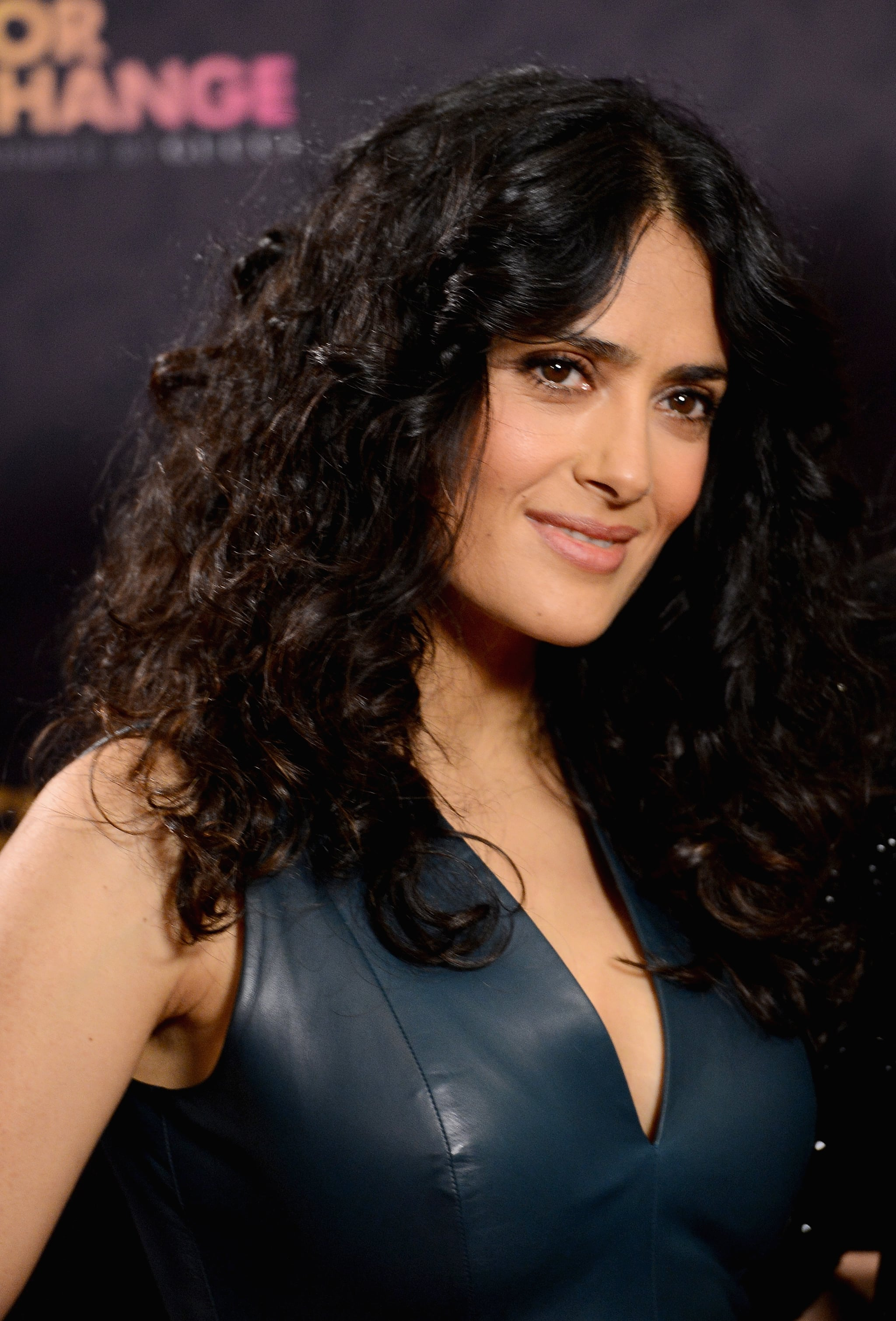 With a head full of curls, Salma Hayek was stunning at the Chime For Change concert with makeup in a natural palette.