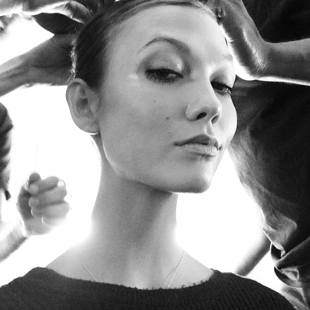 Karlie Kloss snapped a selfie while getting her hair and makeup done for the Carolina Herrera runway show. Source: Instagram user karliekloss