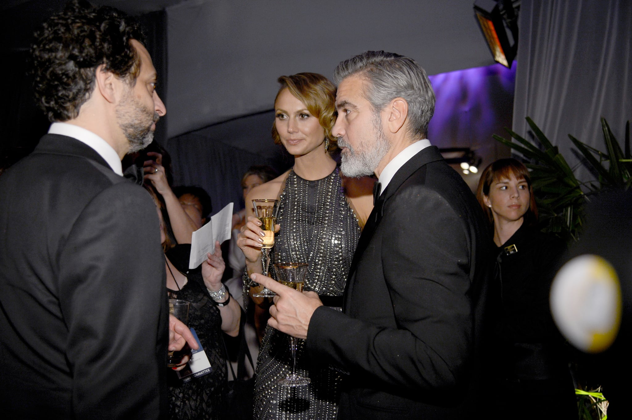 George Clooney and Stacy Keibler toasted with Champange at the Governors Ball after the Oscars.