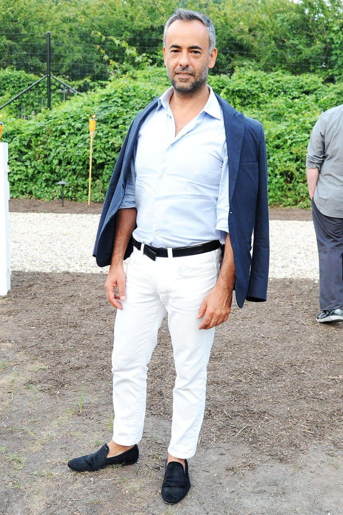 Francisco Costa looked cool and casual while attending the East Hampton Coach cocktail party.