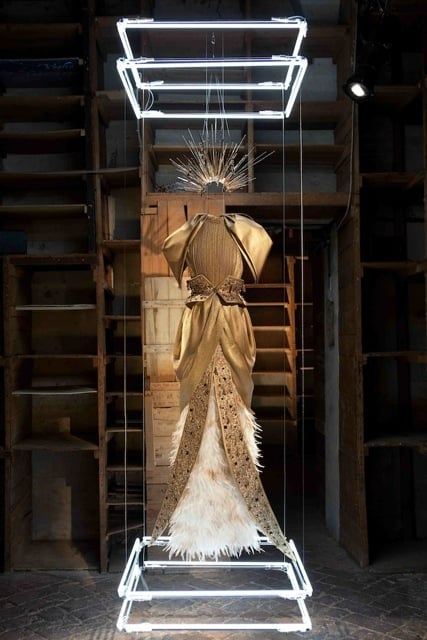 Gold Lame, Silk, and Hammered Sequin Gown with Gold hand painted Feathers and hand beaded Swarovski Crystal Elements with Gold Ray Head Piece