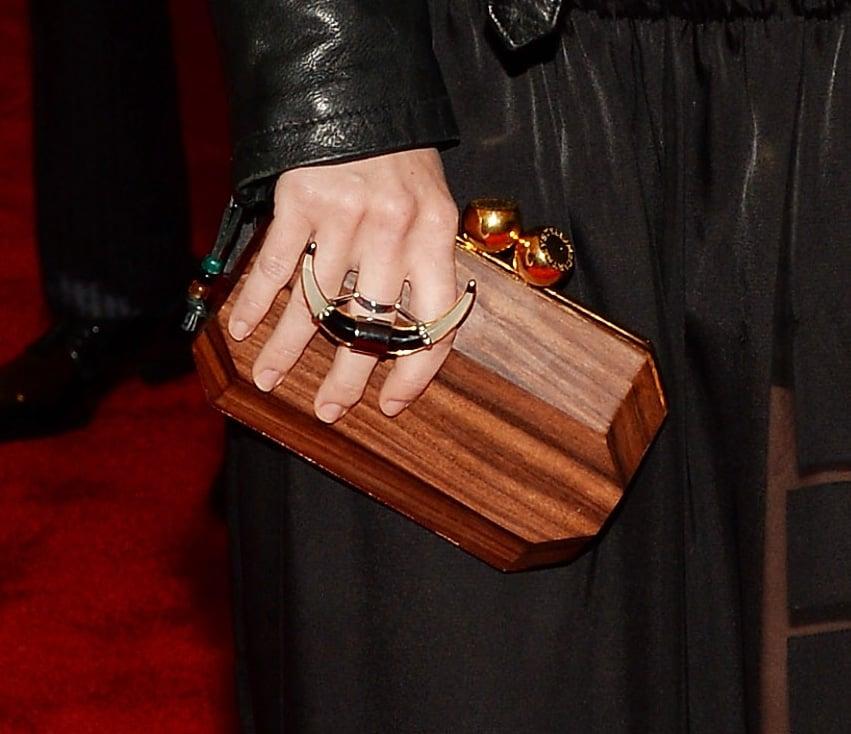 Dree Hemingway carried a wooden minaudière.
