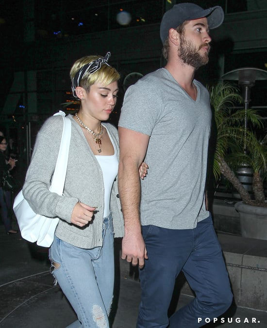 Miley Cyrus held her fiancé Liam Hemsworth's arm while out in LA.