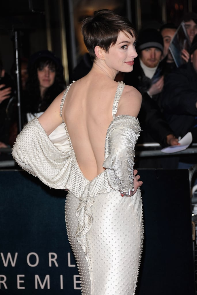A closer look at the draped sleeves and beautiful rhinestone embellishments on her dress.
