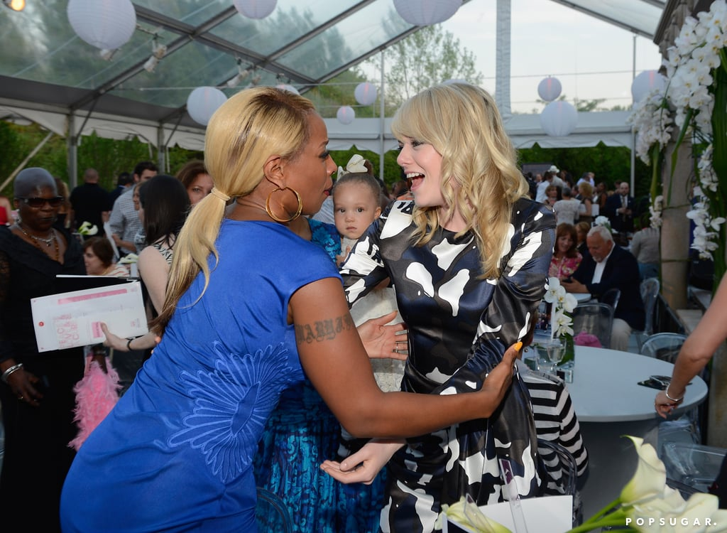 Emma Stone hugged Mary J. Blige at the cocktail reception.