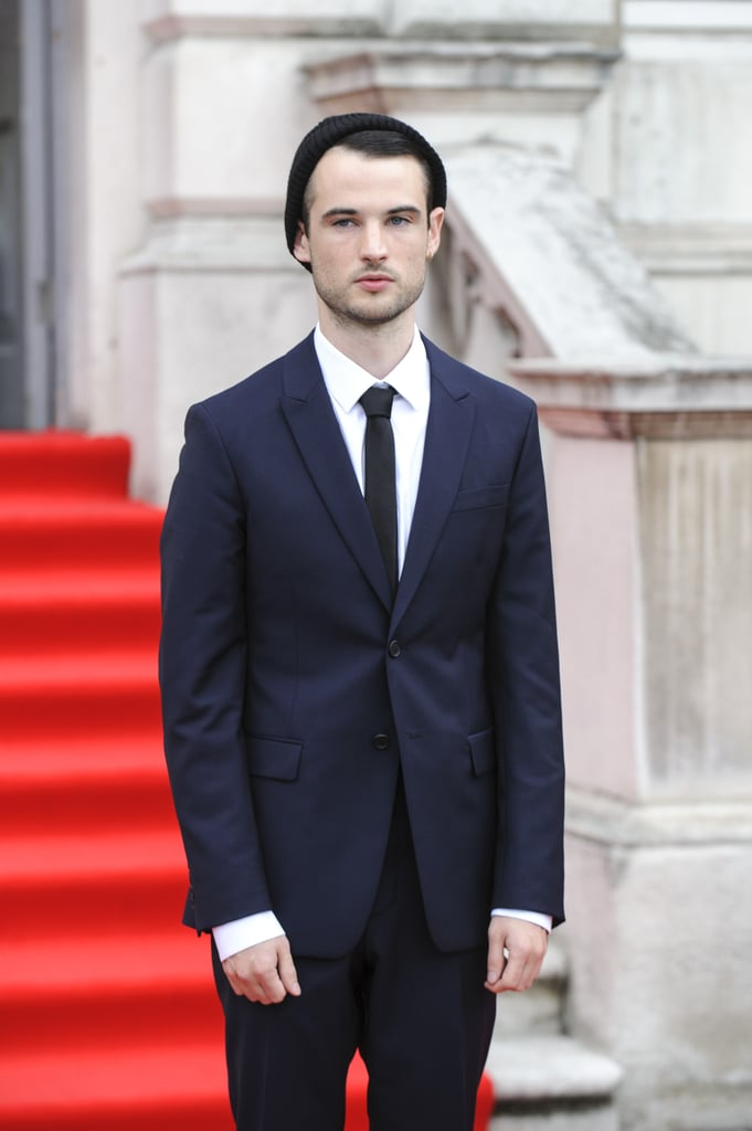 Tom Sturridge donned a blue suit and skinny tie.