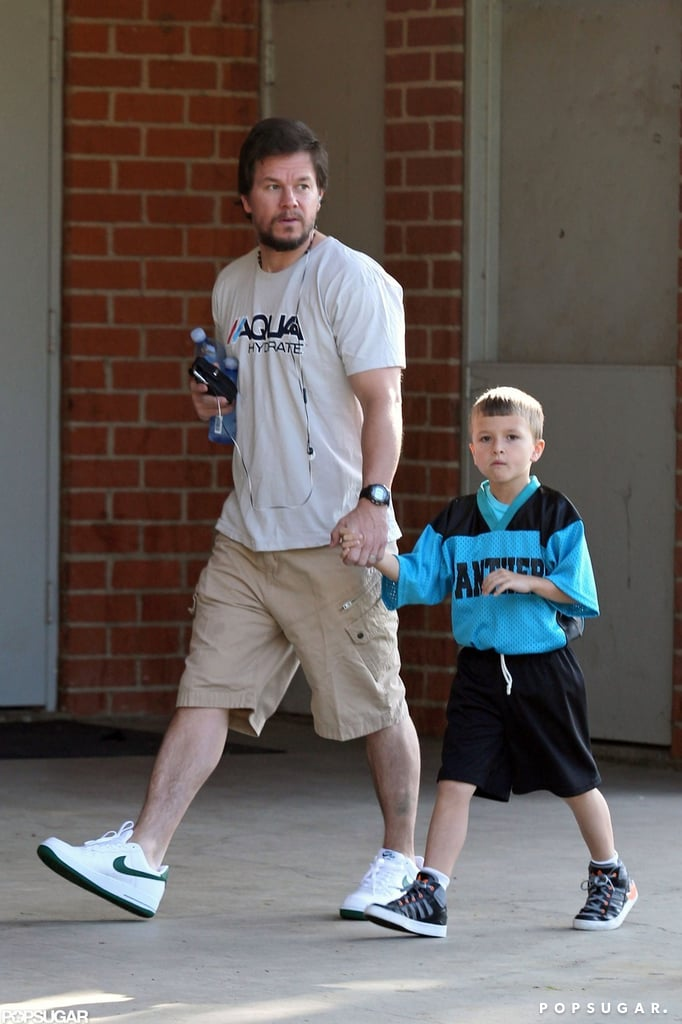 Mark Wahlberg and Michael Wahlberg walked holding hands.