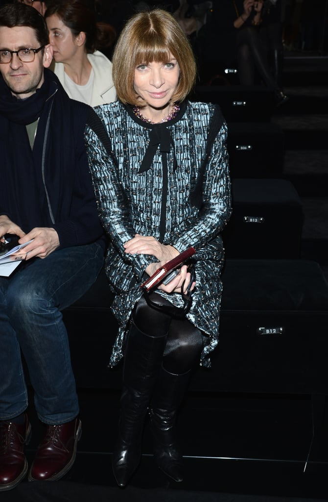 Anna Wintour paired a printed suit set with black leather boots and her signature bob for a polished look at Gucci.