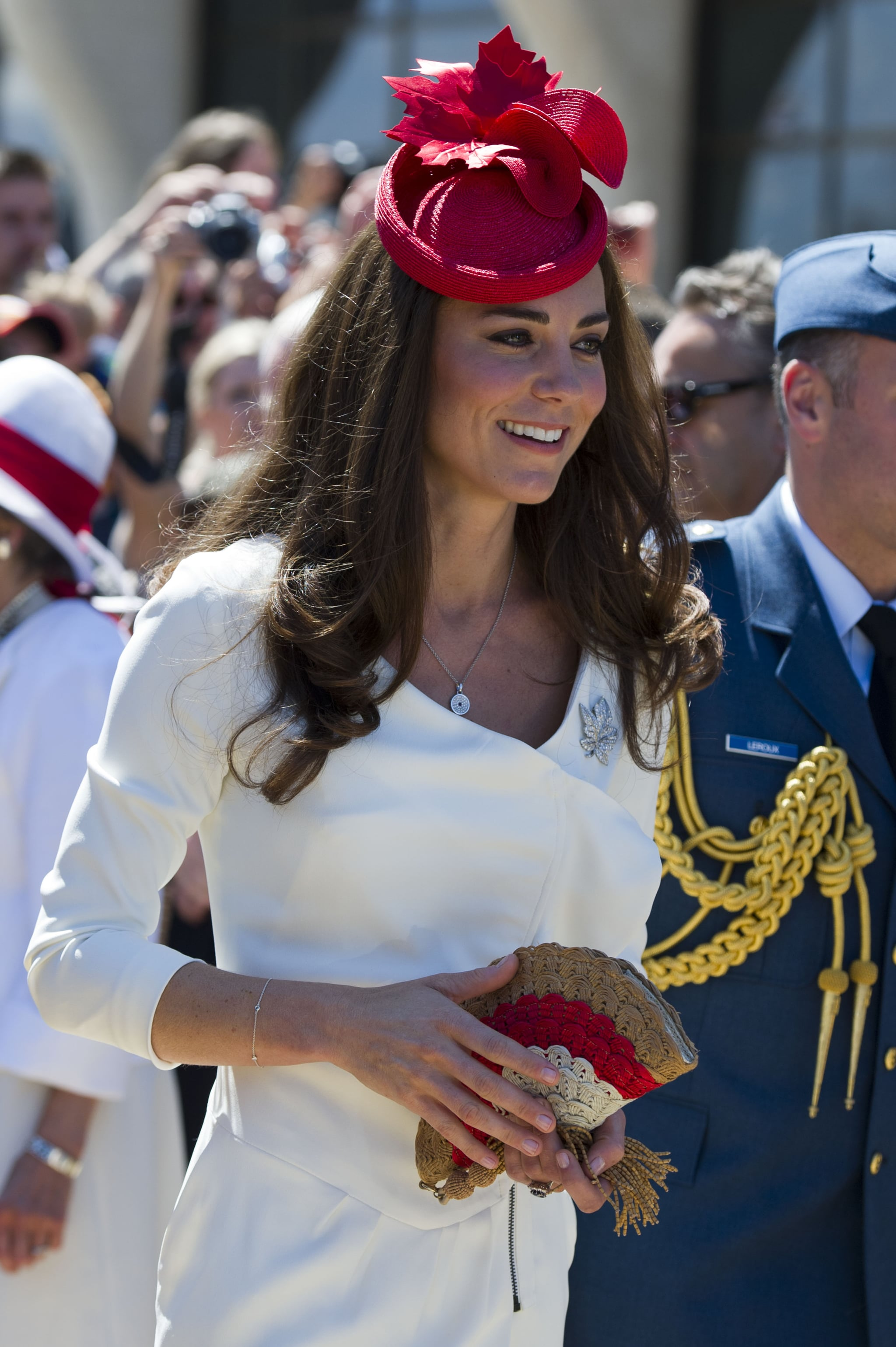July 1st, 2011  Arriving for a citizenship ceremony at the Canadian Museum of Civilization in Gatineau, Canada.  In honor of Canada Day and the nation's 144th birthday, Kate wore a red maple leaf fascinator from Lock and Co. The diamond maple leaf pin is on loan from the Queen.