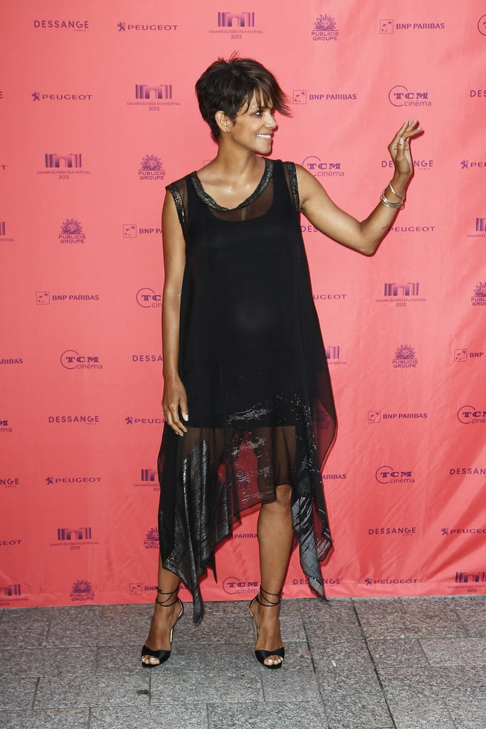Halle Berry covered her baby bump in a black dress in Paris.