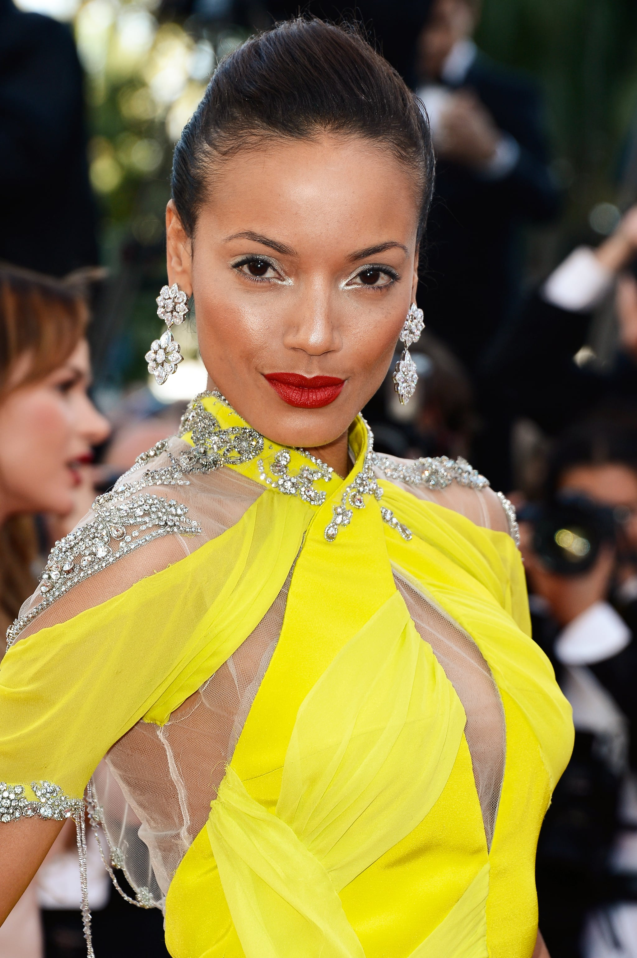 Selita Ebanks worked the Blood Ties red carpet in a shocking neon yellow gown. She wore her hair slicked back and went for shimmering eye makeup and a matte red lip.