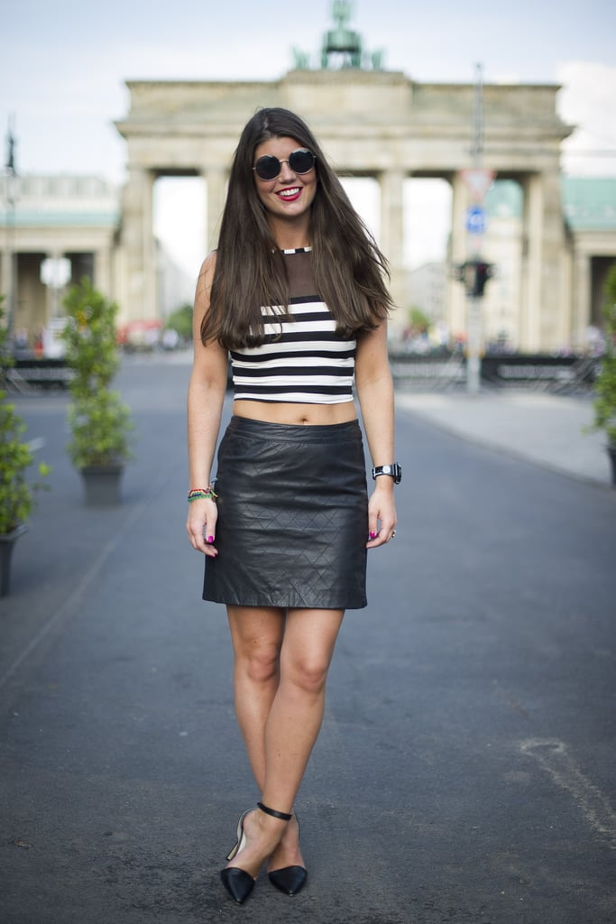 A black leather skirt found a daring companion in a black and white striped crop top.