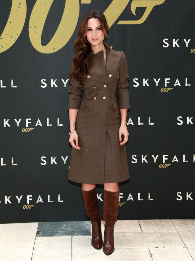Bérénice Marlohe showed off her classic casual style at the Skyfall photocall in NYC wearing a Salvatore Ferragamo military coat with Tods knee-high boots.