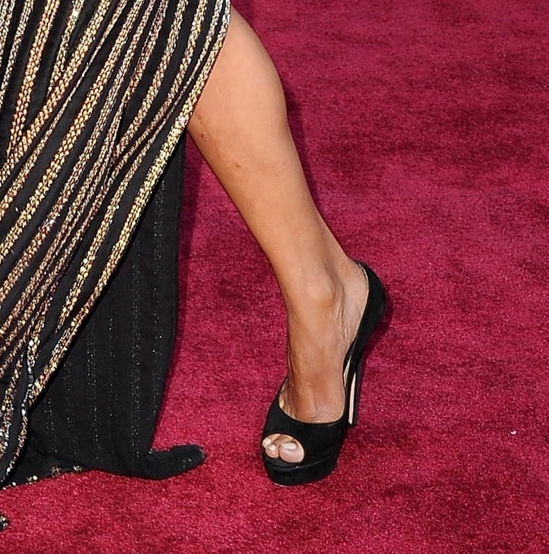 When Halle Berry strutted in her metallic striped Versace gown at the Academy Awards, she showed off a pair of classic black peep-toe pumps.