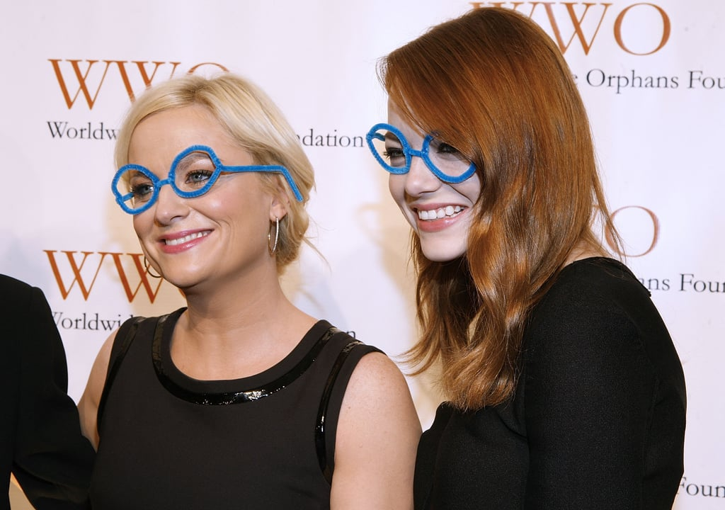Emma Stone goofed around with pal Amy Poehler at a benefit gala in November 2011.