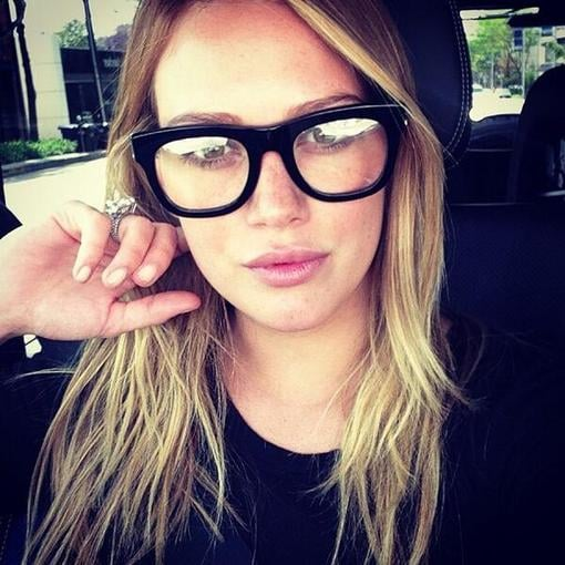 """Hilary Duff had a """"nerdy kind of day"""" while wearing a pair of thick-frame glasses. Source: Twitter user HilaryDuff"""