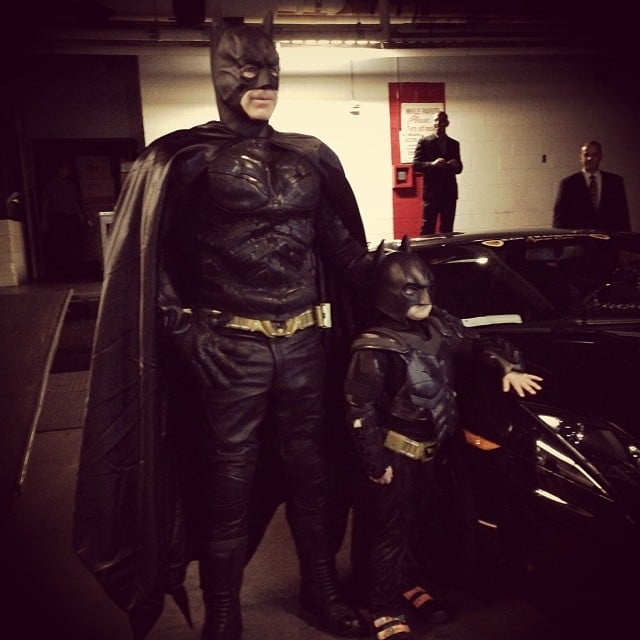 Batkid and his adult helper posed by their Batmobile. Source: Instagram user lisssyyy