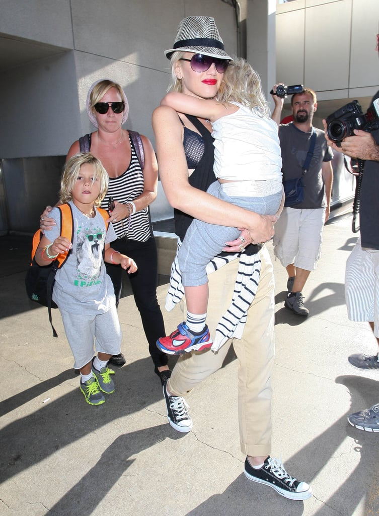 Gwen Stefani touched down at LAX with her boys.