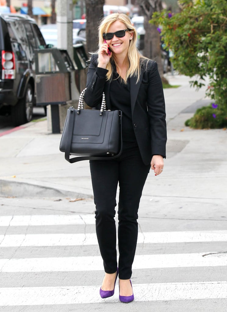 Reese Witherspoon smiled as she talked on her phone in LA in December 2012.