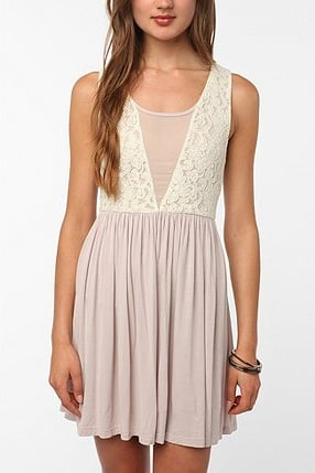 We love the feminine detailing on this one. There's no need to add much here; just add a pair of wood-heeled platforms and you're on your way.  Pins and Needles Knit Lace Mix Dress ($49)