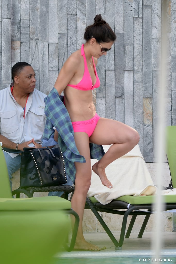 Katie's bikini body was on display during her trip.