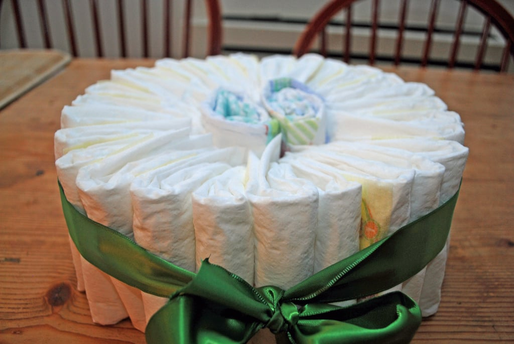 Keep adding diapers until it is full. Stuff the center with more diapers to help the layer keep its shape.