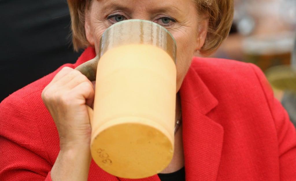 Angela Merkel threw back a stein during a 2009 rally.
