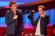 Catching Fire's Sam Claflin took over the microphone as Josh Hutcherson raised the roof while accepting the best movie award.