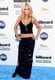 Jenny McCarthy went the midriff baring route, pairing a cropped tank top with a semisheer racer-band maxi skirt to complete the effect.