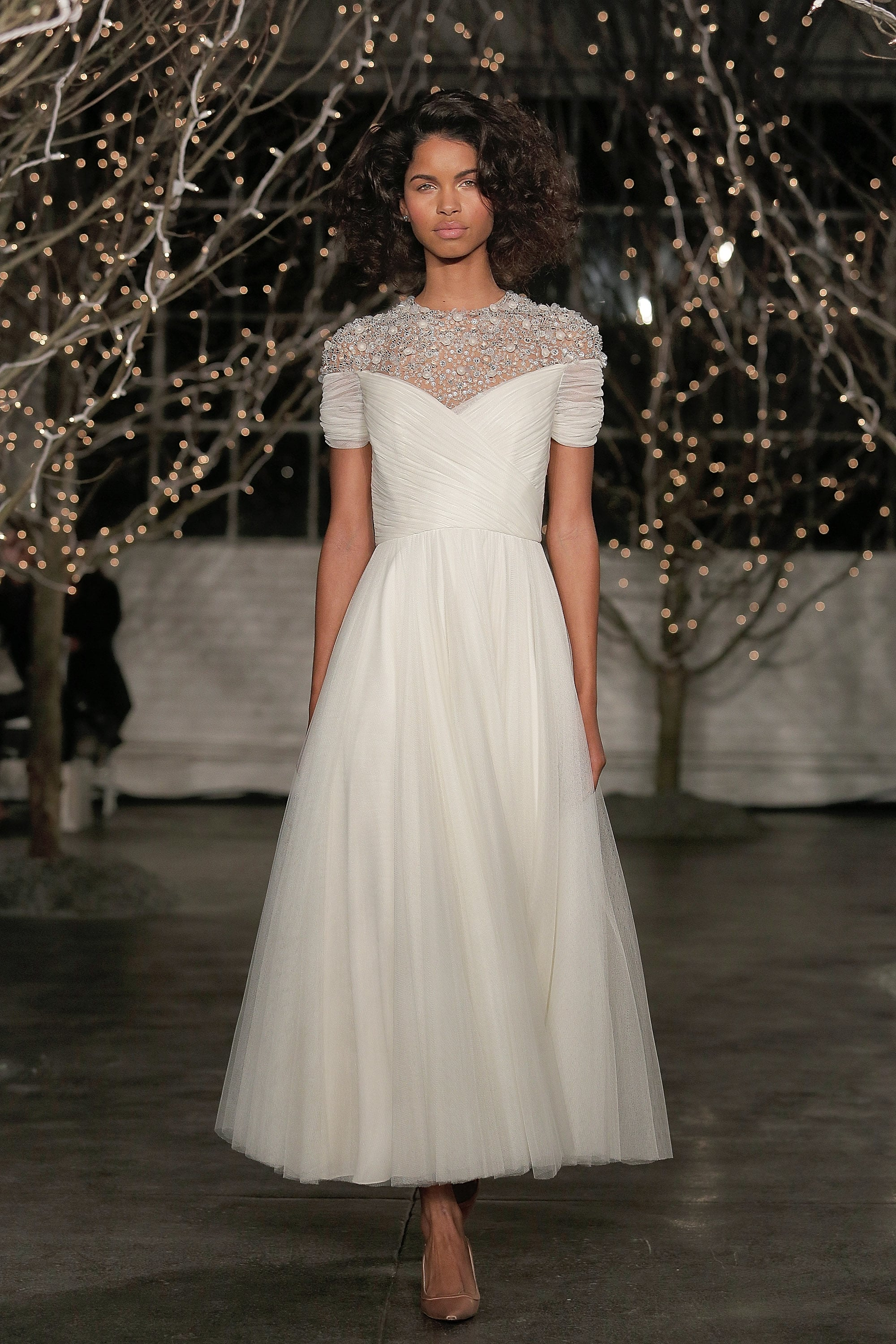 Of course, if she were to change it up, we could easily see the lovely Pippa in something sweet, like this gown from the Jenny Packham Fall 2014 collection.