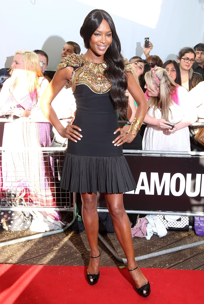 Naomi Campbell looked regal in a black minidress with heavy gold embellishments along the neckline at the Glamour Women of the Year Awards in London.