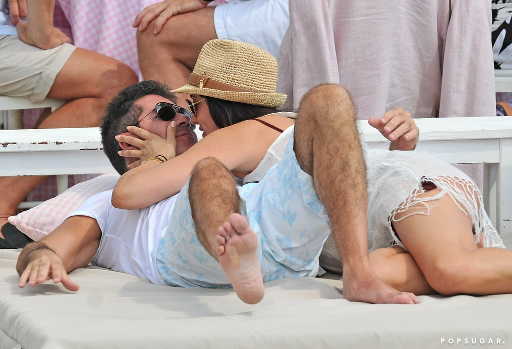 Lauren Silverman planted a kiss on Simon Cowell during a beach day in St.-Tropez in August 2013.