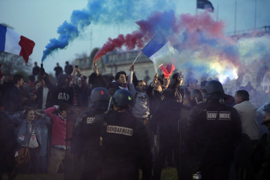 Anti-gay-marriage protesters burned flares during a demonstration a few days before the vote.