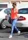 Alessandra Ambrosio punched up her daytime LA style via a neon orange sweater and tie-dye Triarchy denim, then added further funkiness via white sunglasses and white Isabel Marant sneakers.