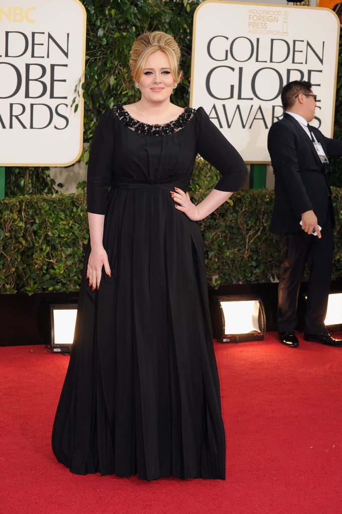 Three months after giving birth to her son, Adele made her postbaby debut wearing a black Burberry gown at the award show.