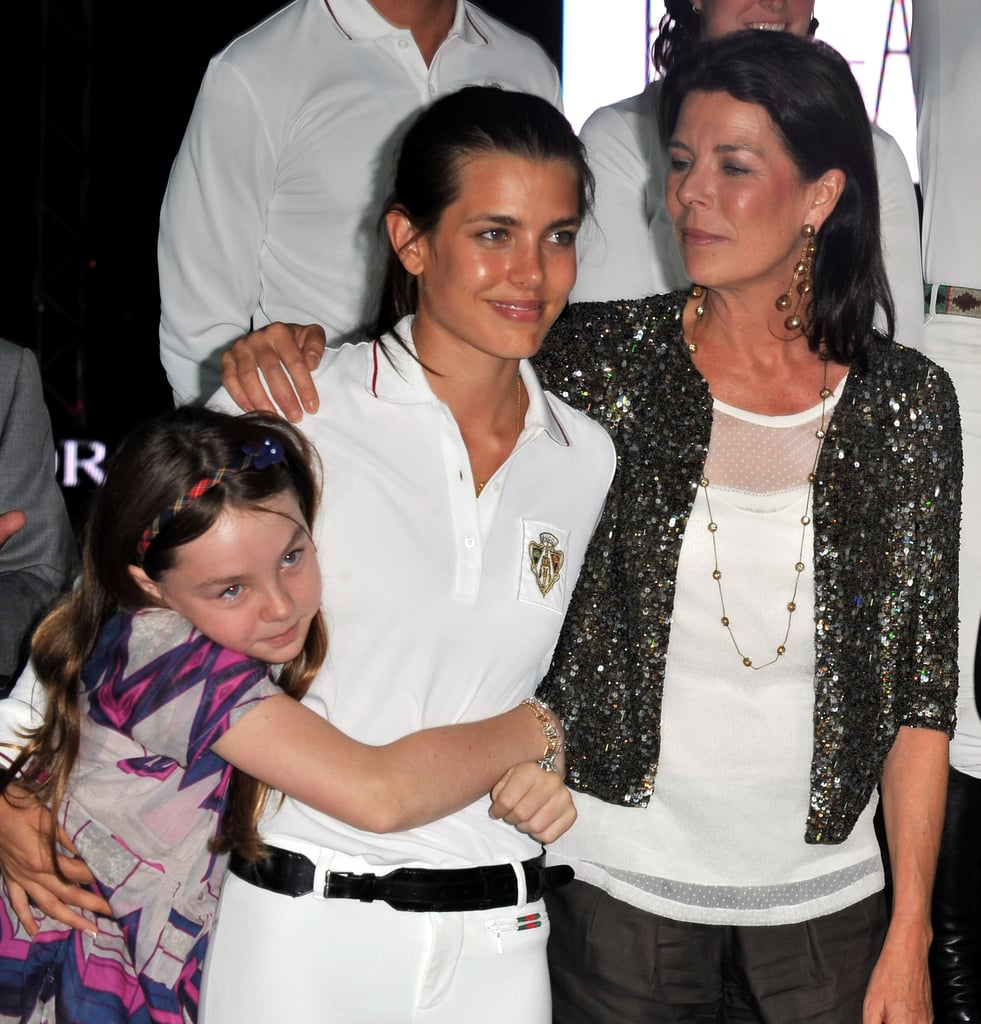Charlotte got hugs from her mother, Princess Caroline, and her younger sister, Alexandra, at a 2010 jumping event.