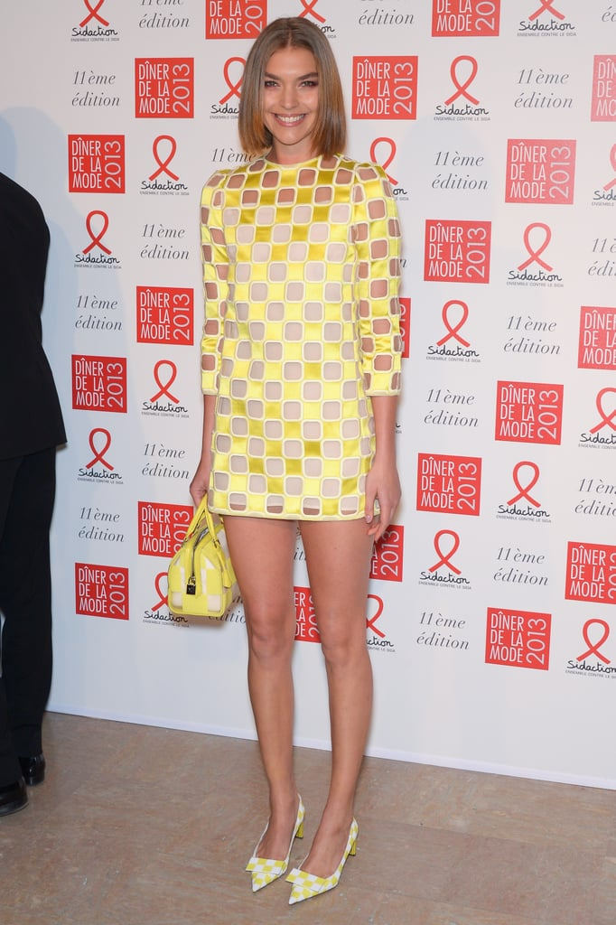 Arizona Muse nailed the mod look in a bright yellow checkered Louis Vuitton Spring '13 number at the Sidaction Gala.