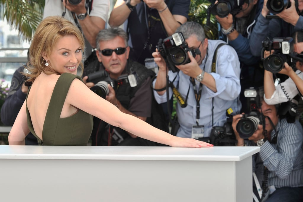 Kylie Minogue posed before a group of photographers at the photo call for Holy Motors in Cannes on May 23.