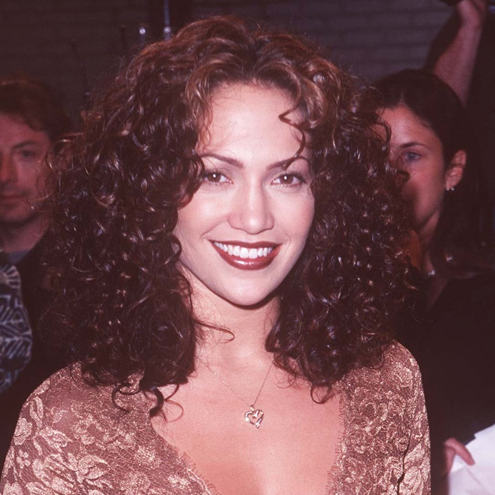 For the 1997 premiere of Anaconda, Jennifer wore a brick red lip look, along with a bevy of dark curls.