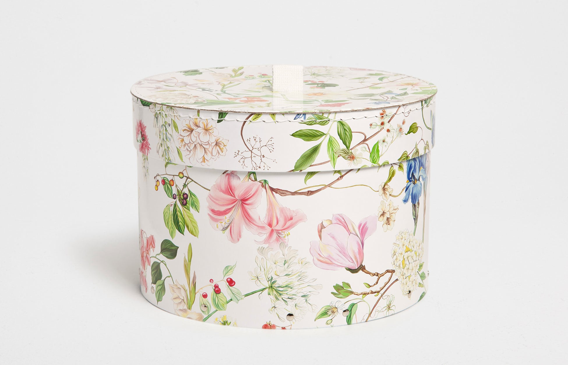 For a bright and organized bedroom, use this botanical-print box ($17-$20) to hold all your knickknacks.
